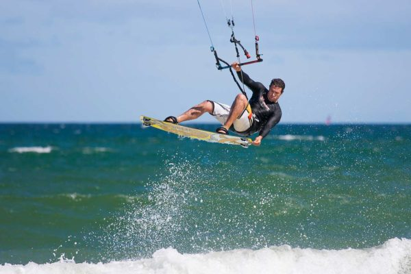 kite-boarder-wave-jumping,-Cape-Town